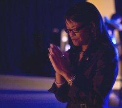 LaShunda Rundles praying